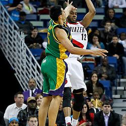 February 10, 2012; New Orleans, LA, USA; New Orleans Hornets power forward Gustavo Ayon (15) defends Portland Trail Blazers power forward LaMarcus Aldridge (12) during the first half of a game at the New Orleans Arena.   Mandatory Credit: Derick E. Hingle-US PRESSWIRE