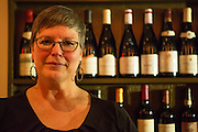 New York, NY - 27 May 2014. The Simone's General Manager Tina Vaughn with a selection of wines.