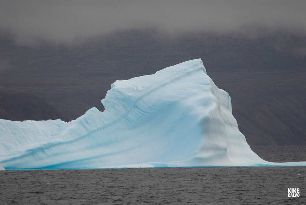 Icebergs from Greenland, drifting on Iceberg Alley. Davis Strait. Baffin Bay.  Baffin Island. High Arctic. Canada&amp;#xA;( environment, global warming, ice, snow, white, blue, turquoise, inmense, mass, block, glacier, foggy, fog, ocean, arctic circle, winderness, view, trip, exploration, wild, scenic, scenics, seascape, tourist, cold<br />