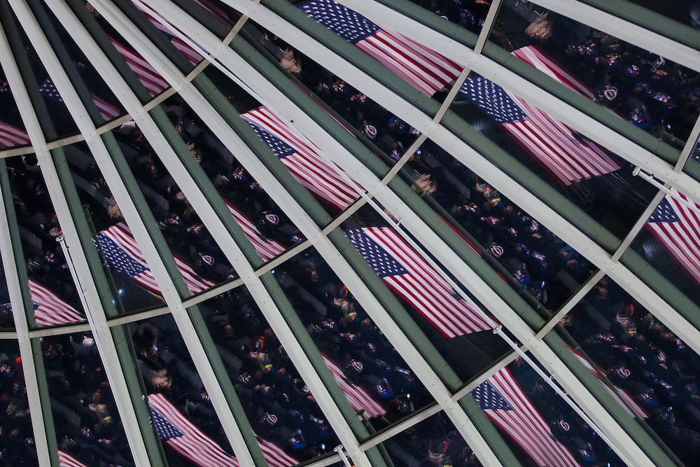 American Flags are reflected in the glass ceiling at the Charles H. Wright Museum of African American History prior to a rally for Democratic presidential candidate Hillary Clinton in Detroit, Michigan, March 7, 2016.