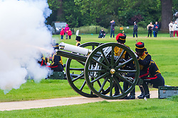 Hyde Park, London, June 2nd 2016. Soldiers and guns of the King's Troop Royal Horse Artillery fire a 41 round Royal Salute to mark the 63rd anniversary of the coronation of Britain's Monarch HM Queen Elizabeth II. PICTURED: A gun discharges flame as it fires.