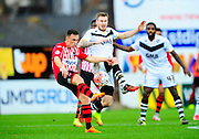 Exeter City's Jordan Tillson and Port Vale's Michael O'Connor during the The FA Cup match between Exeter City and Port Vale at St James' Park, Exeter, England on 6 December 2015. Photo by Graham Hunt.