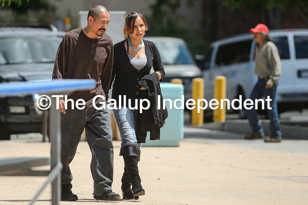 081315       Cable Hoover<br /> <br /> Savona James walks with a companion to the McKinley County Courthouse for her trial Thursday in Gallup. James is accused of the second-degree murder of Kimberly Yazzie.