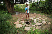 A girl pulls water from a well in the village of Kabe, Mali on Monday August 30, 2010.