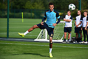 Dele Alli stretches off during Tottenham Training Session at Tottenham Training Centre, Enfield, United Kingdom on 13 September 2016. Photo by Jon Bromley.