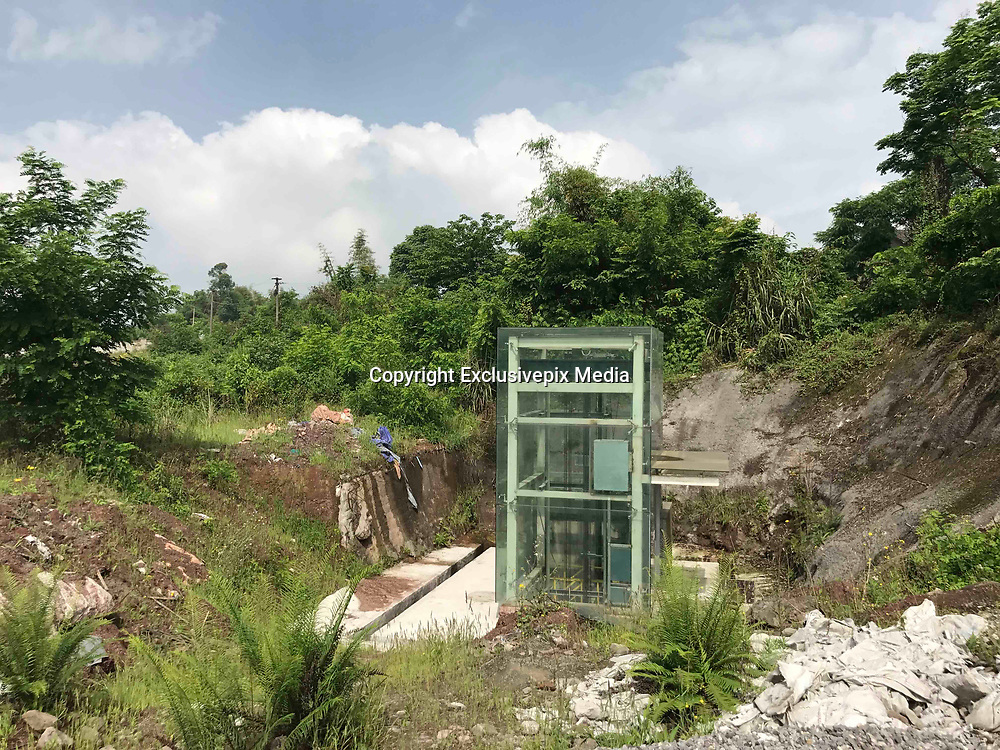 CHONGQING, CHINA - MAY 08: <br /> <br /> Metro Station Opens At Wasteland<br /> <br /> The unopened elevator of Caojiawan Station on Chongqing Rail Transit Line 6 is seen at a wasteland on May 8, 2017 in Chongqing, China. The metro station exits hidden at a wasteland in Chongqing go viral on web. Caojiawan Station on Chongqing Rail Transit Line 6 opened one exit in 2015. As few passengers board from Caojiawan Station, other two exits are hardly seen in the grass, and there's no path leading to the station on the wasteland. <br /> ©Exclusivepix Media