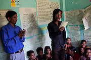 Chandraseker Shahi, 17, sings a self-written song against child marriage at the Kishuri Sachetana Child Club in their activity center in Thahuri Tole, Chhinchu, Surkhet district, Western Nepal, on 1st July 2012. These Child Clubs, supported by the government, Save the Children and their local partner NGO Safer Society, advocate for child rights and against child marriages and use peer support and education to end child marriages and raise awareness. Photo by Suzanne Lee for Save The Children UK