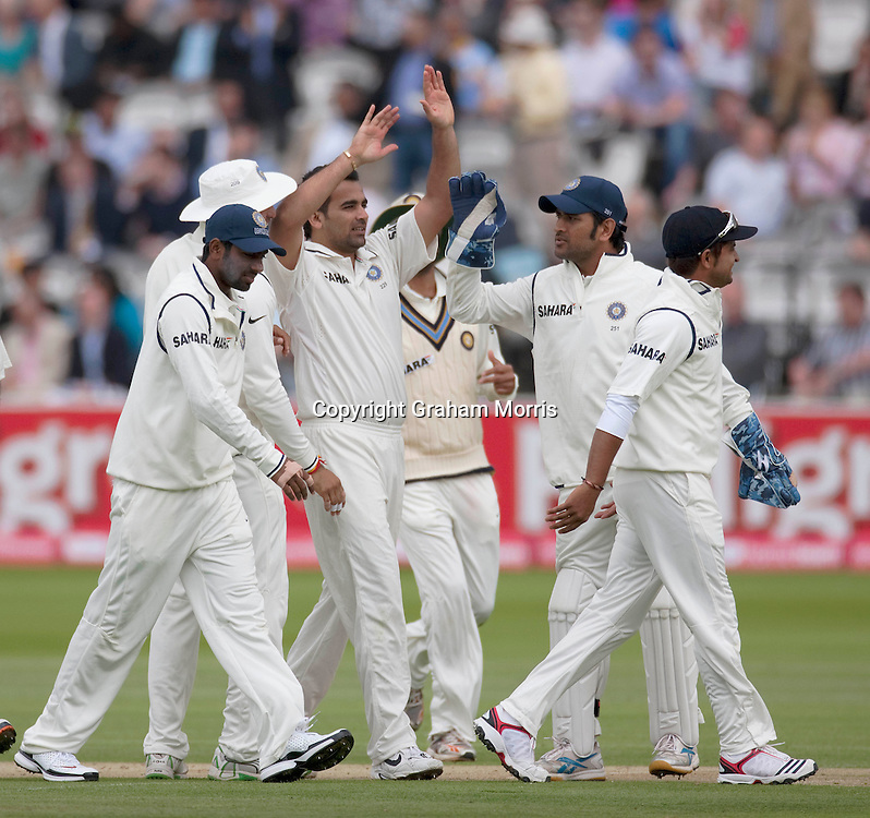 Zaheer Khan celebrates taking the wicket of Andrew Strauss during the first npower Test Match between England and India at Lord's Cricket Ground, London.  Photo: Graham Morris (Tel: +44(0)20 8969 4192 Email: sales@cricketpix.com) 21/07/11