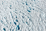 Meltwater pools within crevasses created by the melting and subsequent stretching of the Greenland ice sheet, 60km east of Ilulissat, August, 2014.