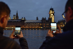 © Licensed to London News Pictures. 22/03/2018. LONDON, UK.  A projection of the words #LondonUNITED is seen on the Houses of Parliament on the first anniversary of the Westminster Bridge terror attack.  The projection is part of the #LondonUNITED tribute initiative by the Mayor of London to the victims in the terror attacks in the capital in 2017.  Similar projections will take place on the first anniversary of the terror attacks which took place at London Bridge, Finsbury Mosque and Parsons Green.  Photo credit: Stephen Chung/LNP
