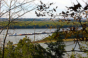 October 2009: View of  a tug boat pushing several barges from an outlook in the Mississippi Palisades State Park. Sights to see in and around Galena Illinois. This image was produced in part utilizing High Dynamic Range (HDR) or panoramic stitching or other computer software manipulation processes. It should not be used editorially without being listed as an illustration or with a disclaimer. It may or may not be an accurate representation of the scene as originally photographed and the finished image is the creation of the photographer.