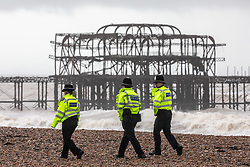 © Licensed to London News Pictures. 17/02/2020. Brighton, UK. Police patrol Brighton Beach as Storm Dennis continues to batter the South Coast with high winds, heavy rain and further risk of flooding. Photo credit: Alex Lentati/LNP
