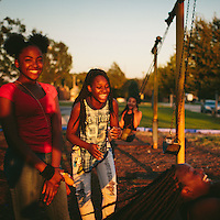East Chicago, Indiana<br /> <br /> From left, friends since childhood, Janae Peyton, 13, Ashanti France, 12, Irene Wooley, 13, and Tniyah Foxx, 12, swing at the park near the West Calumet Housing Complex in East Chicago, Indiana. The playground is part of the Carrie Gosch Elementary School, which has been turned into an EPA office. <br /> <br /> &quot;All my memories are here. I've got to move away from my friends,&quot;  Peyton said.<br /> <br /> ||||<br /> <br /> The West Calumet Housing Complex, which is currently home to about 1,200 people, is located on a 79-acre Environmental Protection Agency Superfund site where a USS Lead facility was located in East Chicago, Indiana. Up until 1985, a lead refinery, a copper smelter and a secondary lead smelter were also in the area. The houses were built between the late 1960s and early 1970s.<br /> <br /> East Chicago is zoned close to 80 percent heavy industrial, and the local government relies on the patronage, jobs and tax revenue that the oil and steel industries bring. However, many jobs disappeared when the steel industry modernized and shifted overseas in the late 20th century, leading to extensive job loss for the working class. People there have a long, complicated relationship with industry -- and its environmental legacy will affect generations to come.<br /> <br /> Photo by Alyssa Schukar