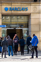 Barclays Bank at the bottom of Barkers Pool Sheffield customers observe social distance recommendations while queuing<br /> Monday 22 March 2020<br /> <br /> www.pauldaviddrabble.co.uk<br /> All Images Copyright Paul David Drabble - <br /> All rights Reserved - <br /> Moral Rights Asserted -