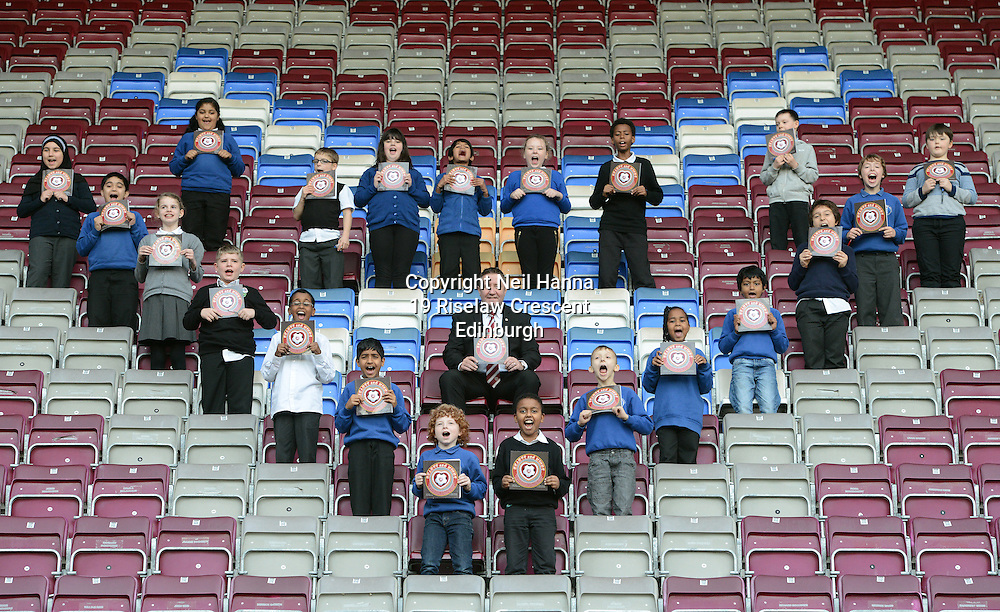 JP License<br /> Wednesday 3 December, Tynecastle Park<br /> <br /> Pic Caption<br /> Daly pupils join Hearts legend John Robertson to show off the new book.<br /> <br /> Heart of Midlothian FC help local Edinburgh primary school pupils launch a <br /> special book of footballing stories written by the children.<br /> 'Hearts and Minds' is a collection of tales penned by the P5-7 pupils at Dalry Primary <br /> School, which is just around the corner from the Tynecastle club.<br /> They put the short stories together with the help of local author Mary Turner <br /> Thomson and P7 teacher Graeme Hawkins.<br /> <br />  Neil Hanna Photography<br /> www.neilhannaphotography.co.uk<br /> 07702 246823