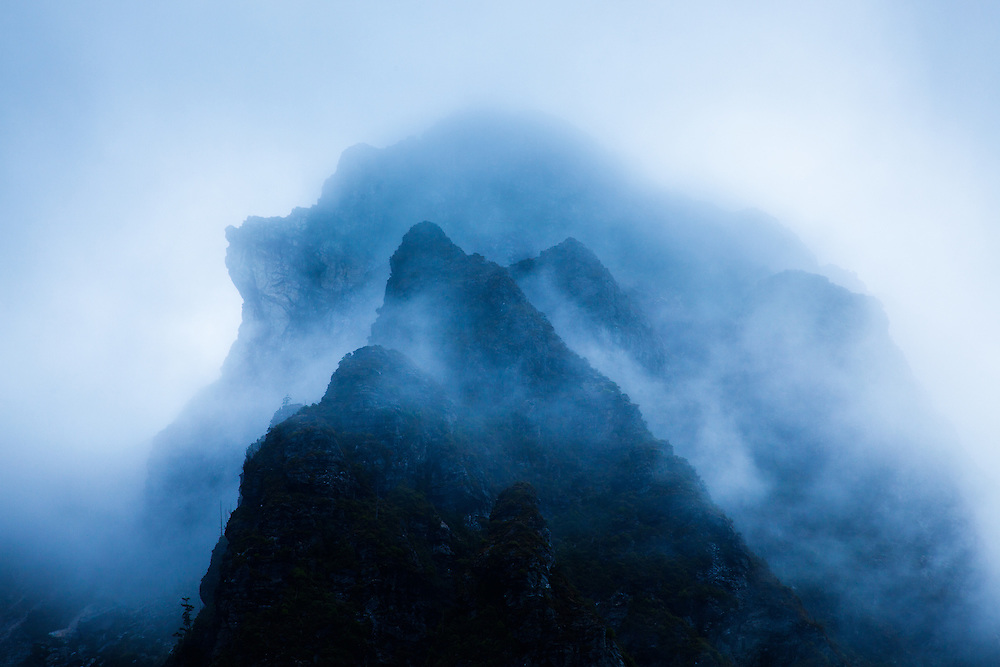 Lions Head adjacent to, Frenchmans Cap, shrouded in clouds, Franklin-Gordon Wild Rivers National Park.