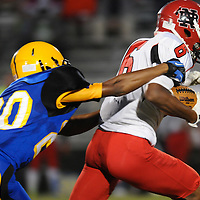 Laney High School's Elijuwan Boone attempts to tackle New Bern High School's Tyric Mccarter Friday September 19, 2014. (Jason A. Frizzelle)