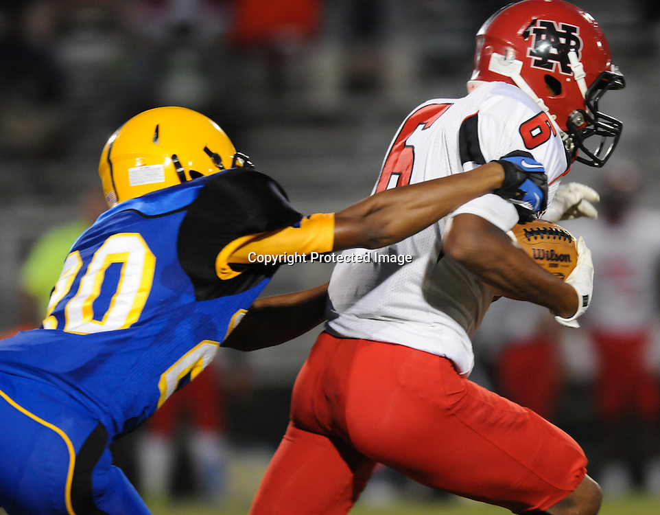 Laney High School's Elijuwan Boone attempts to tackle New Bern High School's Tyric Mccarter Friday September 19, 2014. (Jason A. Frizzelle)