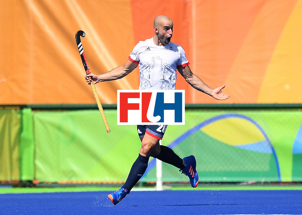 Britain's Nick Catlin celebrates scoring a goal during the men's field hockey Belgium vs Britain match of the Rio 2016 Olympics Games at the Olympic Hockey Centre in Rio de Janeiro on August, 6 2016. / AFP / MANAN VATSYAYANA        (Photo credit should read MANAN VATSYAYANA/AFP/Getty Images)