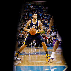 December 17, 2010; New Orleans, LA, USA; Utah Jazz point guard Deron Williams (8) is seen through the legs of an official during a game against the New Orleans Hornets at the New Orleans Arena.  The Hornets defeated the Jazz 100-71. Mandatory Credit: Derick E. Hingle