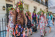 British couturier to royalty, Catherine Walker & Co. stages a showcase of its designs to pay tribute to the RHS Chelsea Flower Show and celebrate its 40th anniversary. Models were dressed in Spring Summer couture, complemented by floral and butterfly head dresses and make-up.