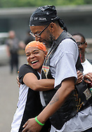 A woman who identified herself as Cookie hugs a man who identified himself as O.G. before the start of a Moving in Peace motorcade thru all of Camden's neighborhoods to recognize and honor the victims of violence in the city Saturday, August 12, 2017 at Farnham Park in Camden, New Jersey. (WILLIAM THOMAS CAIN / For The Philadelphia Inquirer)