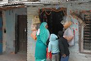 Woman shopping on the road back to Kathmandu from Kopan Monastery.