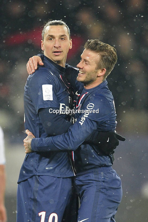 24.02.2013 Paris, France. David Beckham and Zlatan Ibrahimovic celebrate the second goal during the French Ligue 1 game between PSG and Marseille from the Parc des Princes.