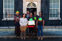 A delegation of Zimbabweans from the weekly Zimbabwe Vigil protest that has been held at Zimbabwe House in London for over 10 years, delivered a petition to Downing Street objecting to the lifting of EU sanctions against the aging Mugabe's regime despite the fact that there have been no political reforms in the country whose large population in the diaspora are denied their right to vote, and where rigging and intimidation are the order of the day in Presidential and Parliamentary elections. PICTURED: A delegation from the Zimbabwe Vigil protest group poses outside No. 10 prior to handing over their petition.