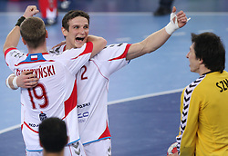Team of Poland (Tomasz Tluczynski (19) of Poland and Bartlomiej Jaszka (2) of Poland) celebrates after winning the 21st Men's World Handball Championship 2009 Bronze medal match between National teams of Poland and Denmark, on February 1, 2009, in Arena Zagreb, Zagreb, Croatia.  Won of Poland 31:23. (Photo by Vid Ponikvar / Sportida)