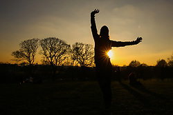 © Licensed to London News Pictures. 20/01/2019. London, UK. A lady exercises during a golden winter sunset on Primrose Hill after a sunny day in the capital. Photo credit: Dinendra Haria/LNP