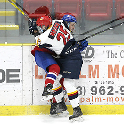 WELLINGTON, ON - FEBRUARY 9: Dylan Massie #25 of the Wellington Dukes makes the hit on the Kingston player during the first period on February 9, 2019 at Wellington and District Community Centre in Wellington, Ontario, Canada.<br /> (Photo by Tim Bates / OJHL Images)