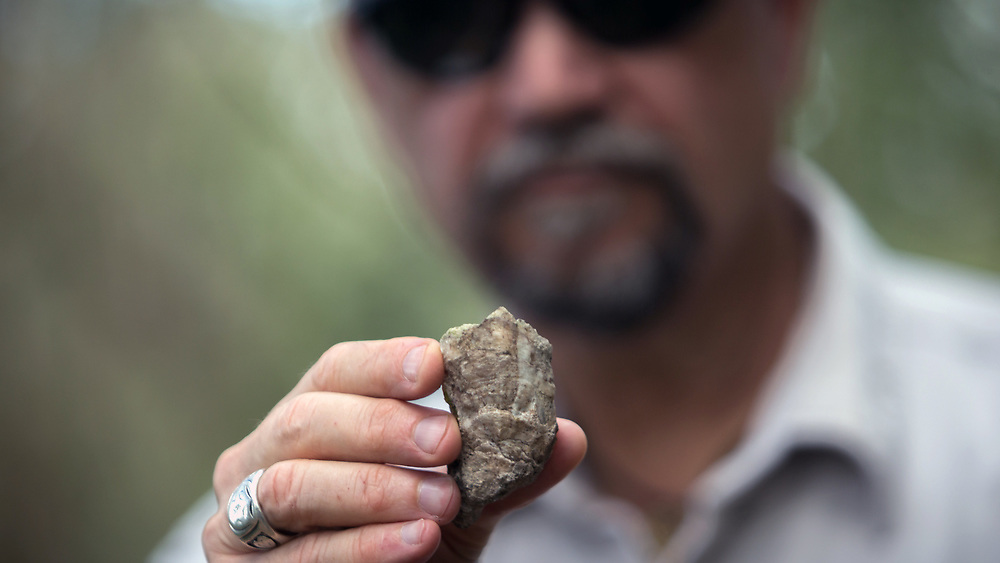 PINCKNEY ISLAND, S.C. - FEBRUARY 20, 2018: Rick Kanaski, Regional Archaeologist for the U.S. Fish and Wildlife Service holds a oyster shell that was used in building a tabby foundation of a building Pinckney Island. (WABE Photo/Stephen B. Morton)