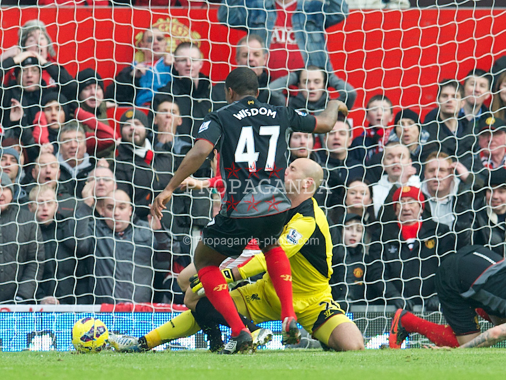 MANCHESTER, ENGLAND - Sunday, January 13, 2013: Liverpool's goalkeeper Jose Reina is clattered by Manchester United's Shinji Kagawa during the Premiership match at Old Trafford. (Pic by David Rawcliffe/Propaganda)