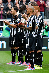 Newcastle United  players applaud before a minutes silence in memory of the two Newcastle fans killed in the MH17 air disaster. Liam Sweeney and John Alder were travelling to New Zealand to watch Newcastle play in a pre-season friendly tournament. - Photo mandatory by-line: Rogan Thomson/JMP - 07966 386802 17/08/2014 - SPORT - FOOTBALL - Newcastle, England - St James' Park - Newcastle United v Manchester City - Barclays Premier League.