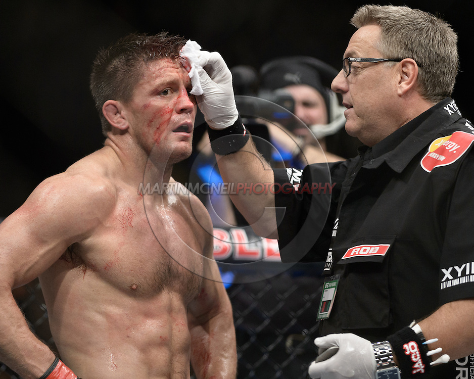 """LONDON, ENGLAND, FEBRUARY 16, 2013: Tom Watson (left) is cleaned by cutman Rob Monroe after his fight at """"UFC on Fuel TV 7: Barao vs. McDonald"""" inside Wembley Arena in Wembley, London on Saturday, February 16, 2013 (© Martin McNeil)"""