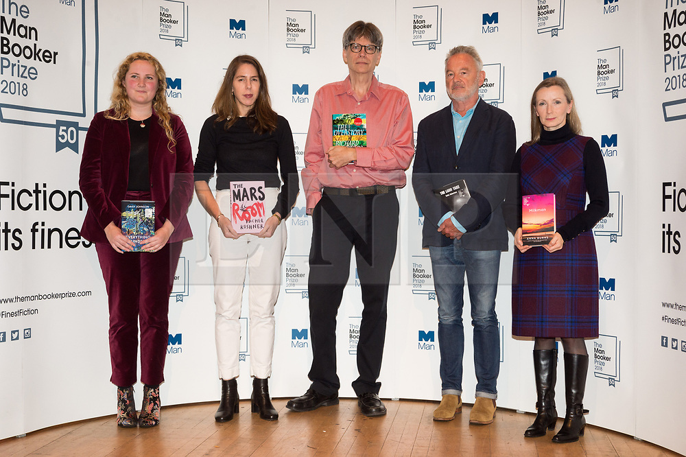© Licensed to London News Pictures. 14/10/2018. London, UK. Authors Daisy Johnson, Rachel Kushner, Richard Powers, Robin Robertson and Anna Burns pose with their books during a photocall at the Royal Festival Hall, two days ahead of the announcement of the winning book of the 2018 Man Booker Prize. Six novelists have been shortlisted for the 2018 Man Booker Prize, a literary prize awarded for the best original novel in English credit: PhotoRay Tang/LNP