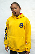 Portrait of young black boy with yellow hoodie and nike jacket, London, 2000's