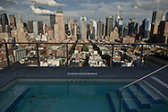 New York, swimming pool on rooftop  midtown manhattan and times square  skyline, view from the rooftop terrce of the hotel Ink 48 New york United states /  piscinne sur le toit, le panorama de times square et midtown.vu depuis la terrasse de l hotel ink 48  New York