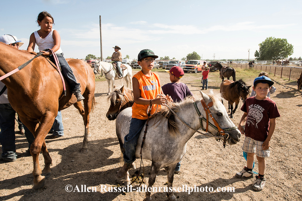 Crow Fair Rodeo, Crow Indian Reservation, Montana, kids, horses