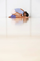 Dancer crouching in prayer position