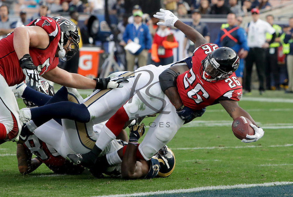 Atlanta Falcons running back Tevin Coleman scores against the Los Angeles Rams during the second half of an NFL football game Sunday, Dec. 11, 2016, in Los Angeles. (AP Photo/Rick Scuteri)