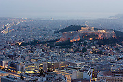 Sunset view of the Acropolis and city center from the top of Lycabettus Hill.