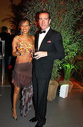 The HON.ROBERT HANSON and SADIE SALVI at Andy & Patti Wong's Chinese New Year party to celebrate the year of the Rooster held at the Great Eastern Hotel, Liverpool Street, London on 29th January 2005.  Guests were invited to dress in 1920's Shanghai fashion.<br />