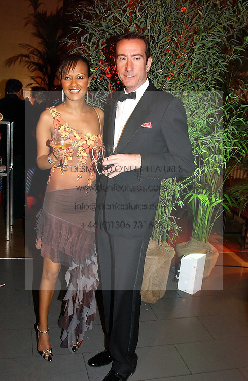 The HON.ROBERT HANSON and SADIE SALVI at Andy & Patti Wong's Chinese New Year party to celebrate the year of the Rooster held at the Great Eastern Hotel, Liverpool Street, London on 29th January 2005.  Guests were invited to dress in 1920's Shanghai fashion.<br /><br />NON EXCLUSIVE - WORLD RIGHTS