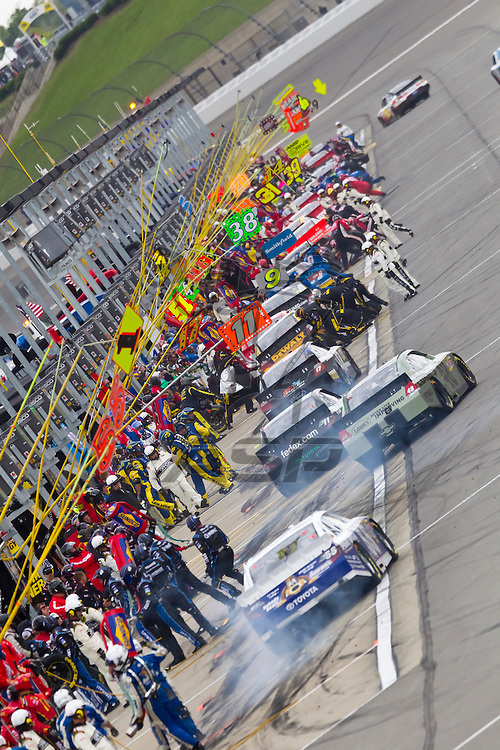 KANSAS CITY, KS - APR 22, 2012:  Mark Martin (55) races during the STP 400 at the Kansas Speedway in Kansas City, KS.