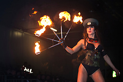 © licensed to London News Pictures. London, UK 02/01/12. A female performer displays a flame show at the Revolution Show as The Carole Nash MCN Motorcycle Show 2012 takes place at ExCeL, London from 2nd-5th Feb 2012. Photo credit: Tolga Akmen/LNP