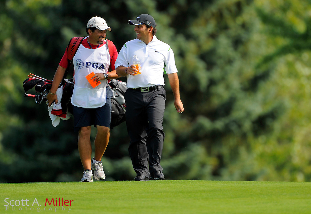 Aug 14, 2009; Chaska, MN, USA; Francesco Molinari (ITA) walks up the third fairway with his caddie during the second round of the 2009 PGA Championship at Hazeltine National Golf Club.  ©2009 Scott A. Miller