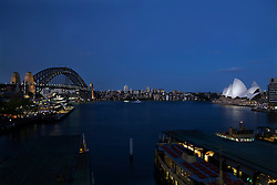 Sydney Harbor at dusk with Sydney Harbor Bridge and Sydney Opera House, Sydney, New South Wales, Australia