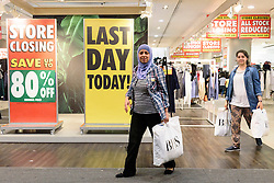 © Licensed to London News Pictures. 13/08/2016. Customers leave with shopping bags as British Homes Stores Oxford Street Flagship store closes on its last day of trading. London, UK. Photo credit: Ray Tang/LNP